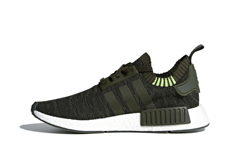 4e969159ddc1 The adidas NMD R1 Surfaces in a Pair of New Glitch-Adorned Color Schemes ·  Footwear