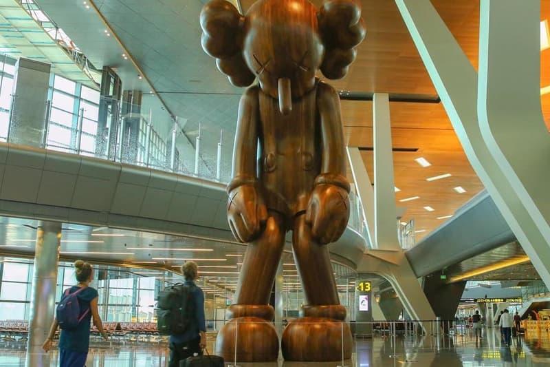 kaws small lie companion sculpture hamad international airport qatar museums art artwork statue