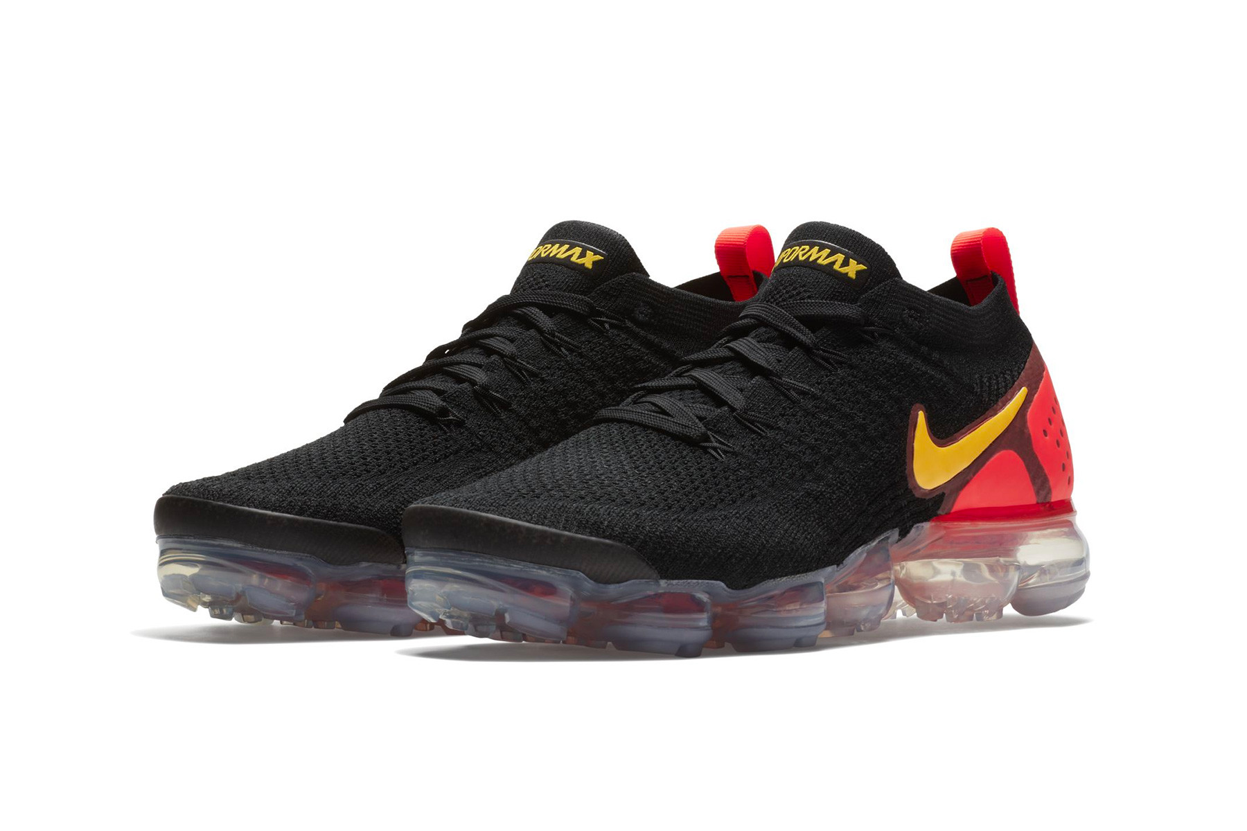 black vapormax with red nike check