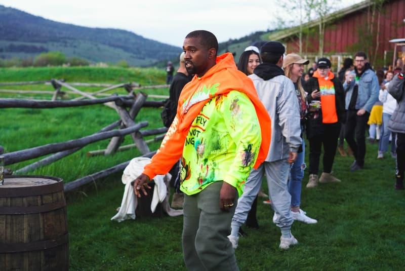 kanye-west-wyoming-album-listening-party-merch-orange-hoodie-yellow-painted-tee-shirt-grey-pants