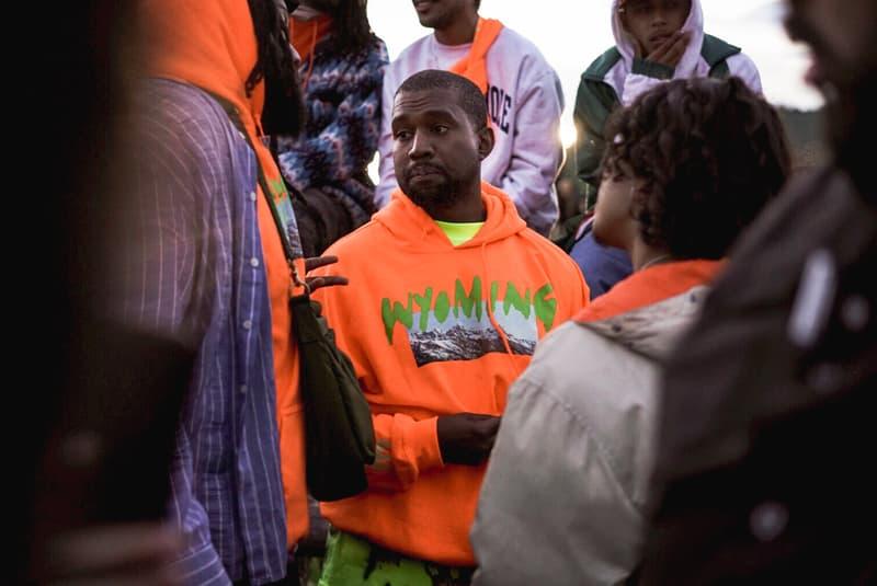 kanye-west-wyoming-album-listening-party-merch-orange-hoodie-yellow-tee-shirt