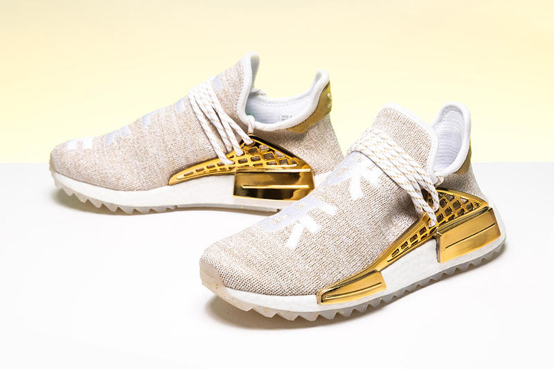 fb683f441e7e Dominated by gold tones. Pharrell adidas Originals NMD Hu Trail China  Exclusive Friends   Family. 1 of 3. Stadium Goods