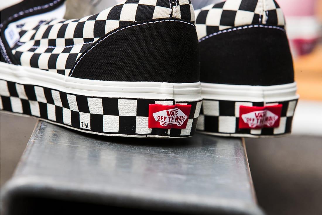slip on black checkered vans