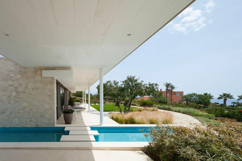 House by the Sea GERNER GERNER Plus Architects Greece Houses Modern Interior Exterior Swimming Pool Plants Mountains Field Hills View Holiday