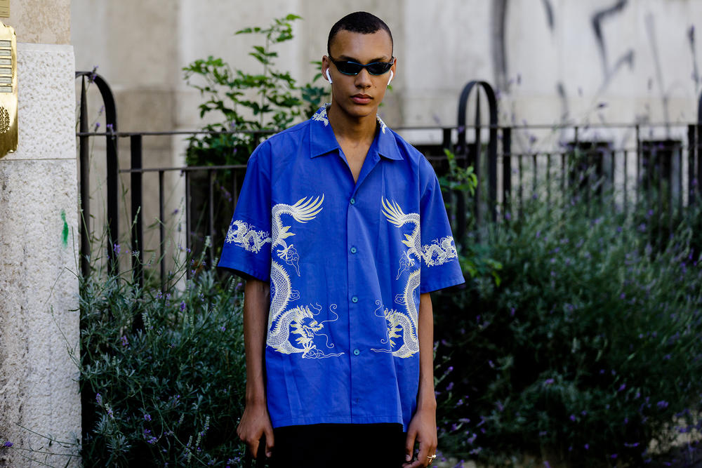 milan fashion week street style spring summer 2019 blue silk dragon tee shirt airpods tiny sunglasses