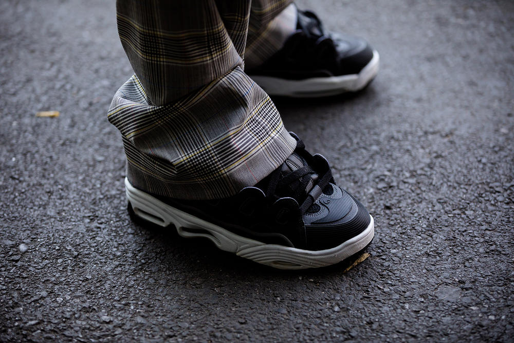 milan fashion week street style spring summer 2019 osiris d3 asap rocky chunky sneaker on feet black white plaid trousers pants slacks