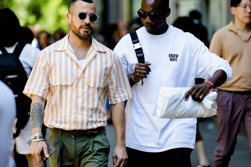 milan fashion week street style spring summer 2019 know wave tee graphic white shirt clutch bag grey green white striped shirt tucked in khaki pants