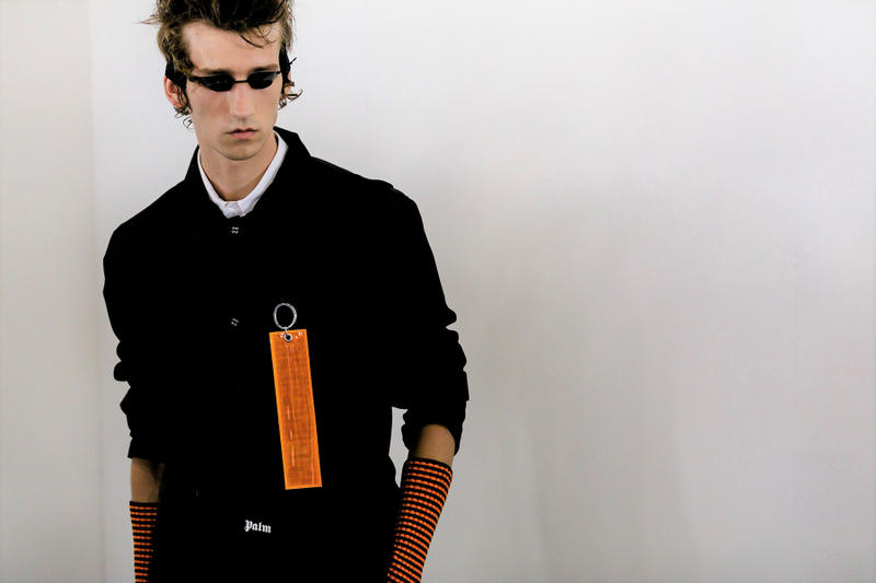 palm angels spring summer 2019 milan fashion week black shirt orange tag tanning bed glasses arm warmers belt logo
