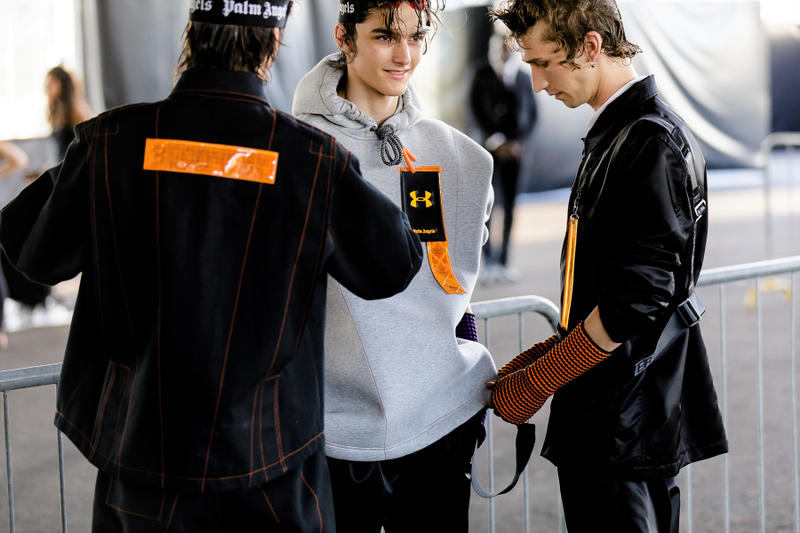 palm angels spring summer 2019 milan fashion week grey sweater hoodie under armour logo black jacket orange tag yellow arm warmers harness