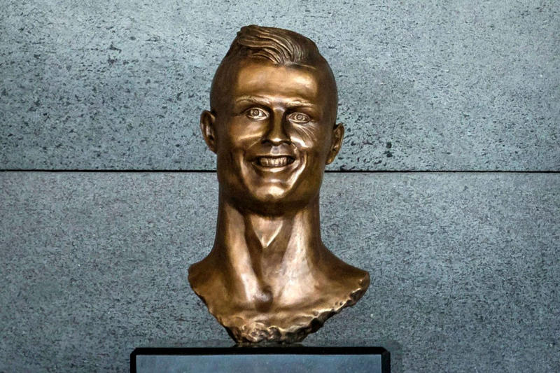 cristiano ronaldo Emanuel Santos bust sculpture swap replace Cristiano Ronaldo Madeira International Airport june 11 2018 statue family bronze portugal