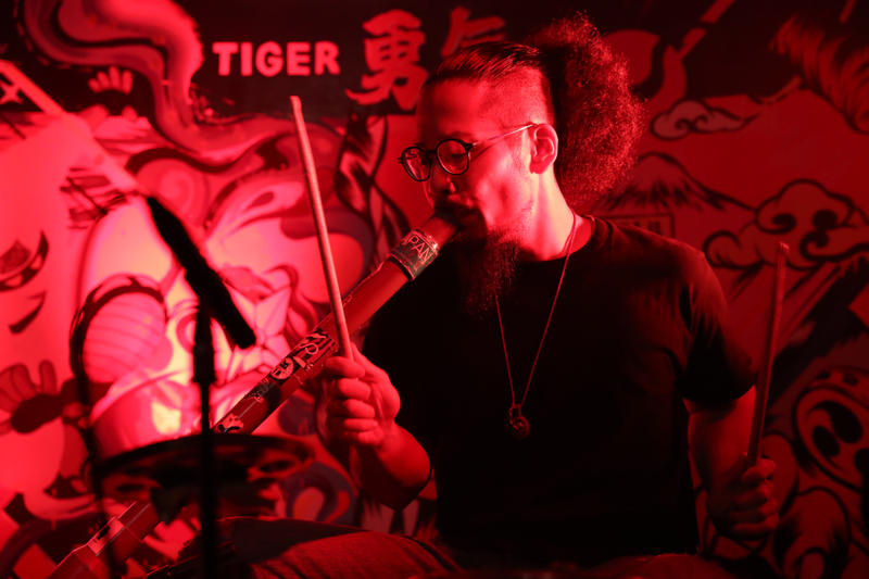 Tiger Beer Uncaged Hero masa japan drumming bucket drummer edm trance techno stick red singapore