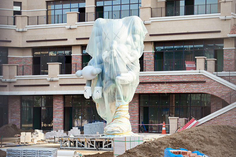 kaws companion sculpture south korea where the end starts statue installation