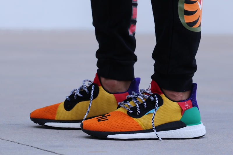 39dd731cf65c7 Pharrell adidas Solar Hu Glide ST Early Look rainbow colorway boost midsole  yellow orange blue pink