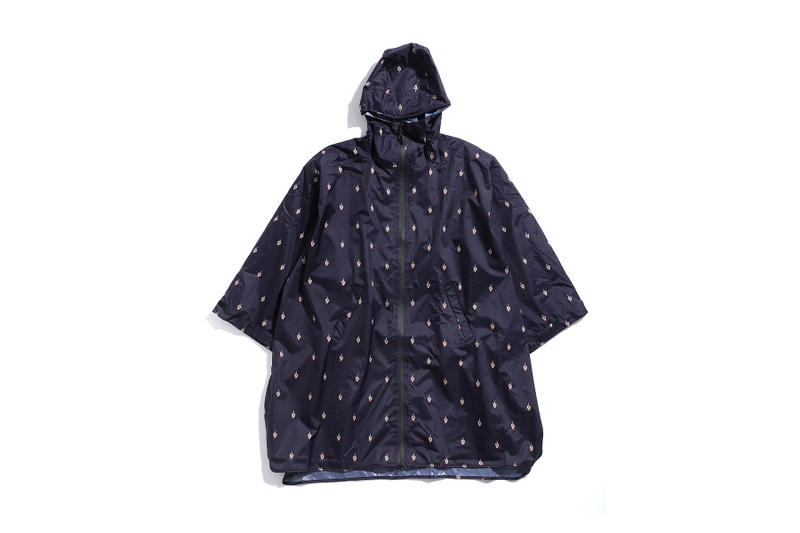 undercover kiu collaboration july 21 2018 printed raincoat blue navy middle finger graphic zipper pocket