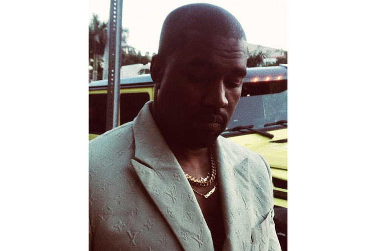 33ad8d77620 Kanye Wears Virgil Abloh-Designed Louis Vuitton Suit With YEEZY Slides