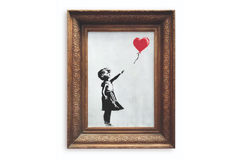 Banksy Artwork Self-Destructs After Auction sotheby's new york city girl with a balloon shredded destroy video street art