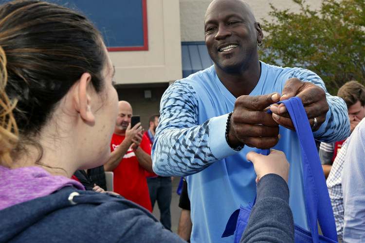 Michael Jordan Hands out Free Sneakers   Thanksgiving Dinners to Hurricane  Victims 7b99c1e08