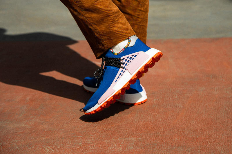 Pharrell x adidas u NMD SOLARHU Pack On foot blue yellow black orange pink white green red