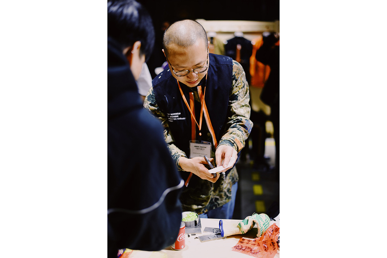 heron preston carhartt wip collaboration collection drop release date info tokyo japan interview street style snaps chen kai williams workshop