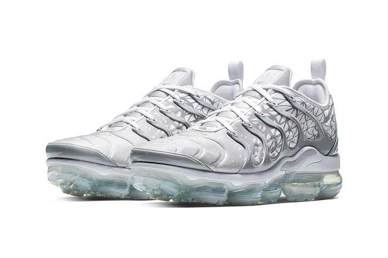 8b38f5b5bbc Complete with abstract patterning. nike air vapormax plus march colorway  white shark motif grey