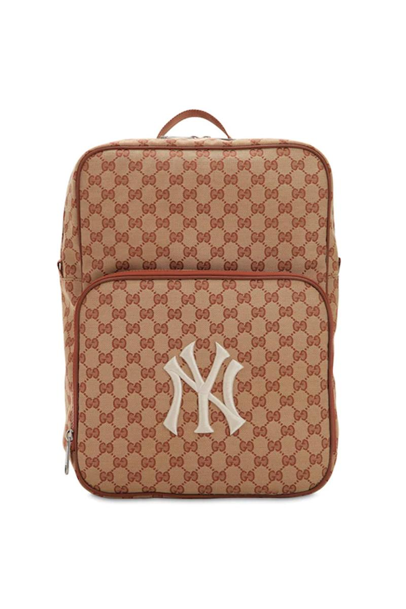 de35d40f12c Following up to the label s monogram baseball cap. gucci gg supreme logo new  york yankees backpack beige ...