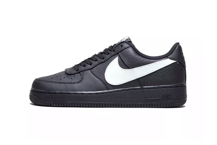 low priced 5a3f4 f5703 Nikes Oversized Swoosh Looks Even Bigger on Air Force 1 Black Colorway