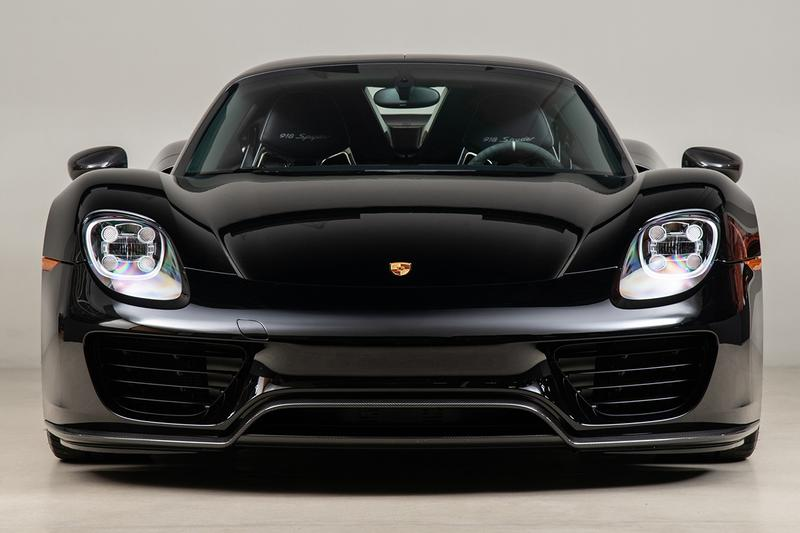 Porsche 918 Spyder Hybrid Onyx Black Silver Accents Environmental Super Car Hypercar Weissach Package 628 miles magnesium motorsport wheels, lighter brake design titanium bolts chassis rear carbon fibre spoilers 214 mph 875bhp 2.4seconds 944 lb-ft torque 4.6ltr V8 Race Engine