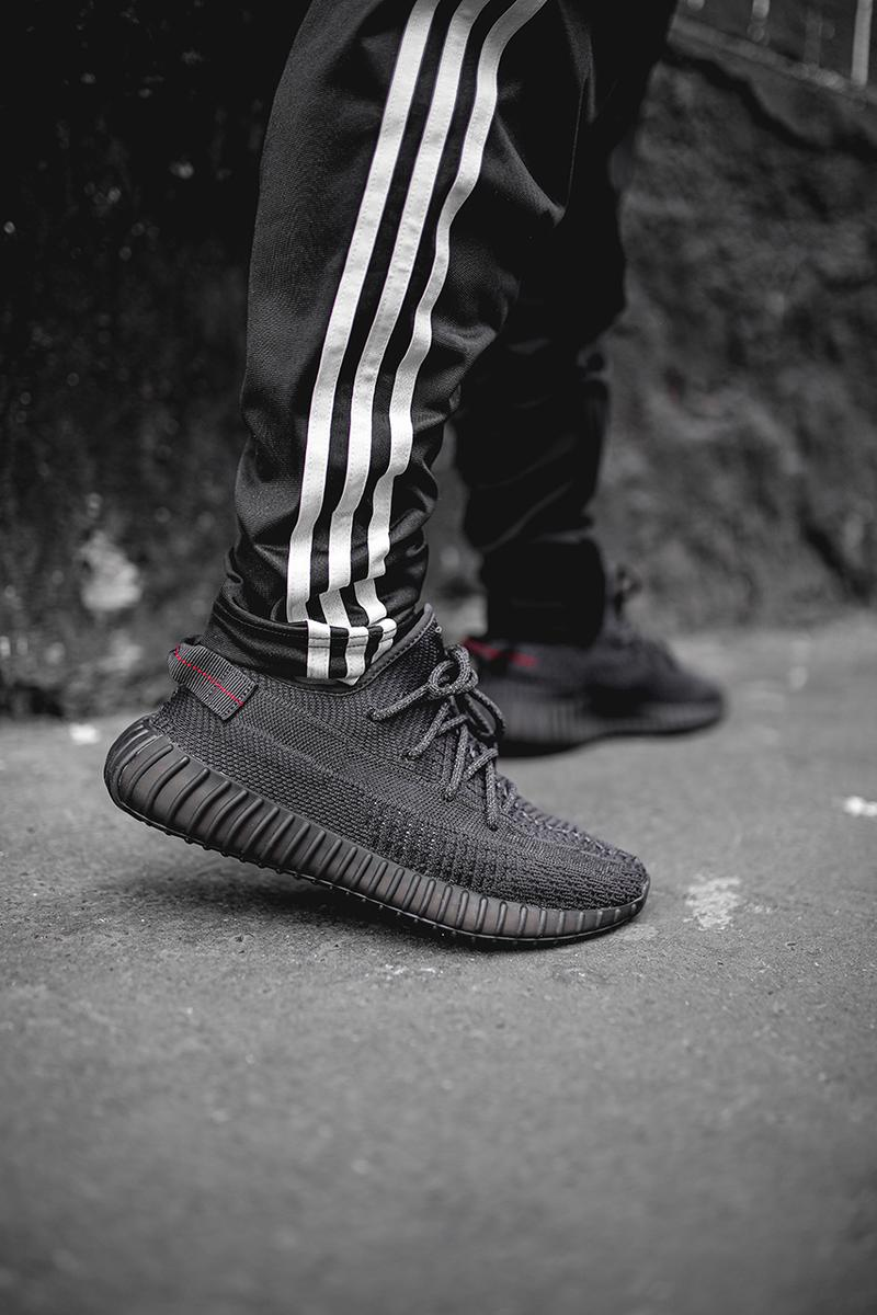 c68e40ff333024 adidas Originals YEEZY BOOST 350 V2 Triple Black colorway release date info  details buy on feet