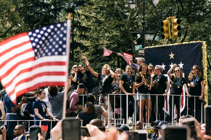 """Chants of """"Equal Pay"""" Echoed Through NYC as the USWNT Celebrated Their World Cup Win"""