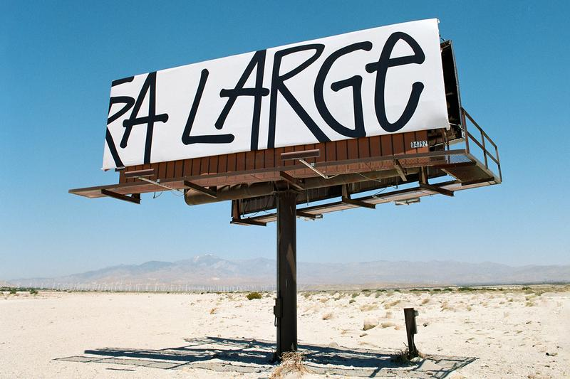 Stussy LIVIN EXTRA LARGE T shirt billboards california desert white black tee motto broadcast blue skies highway campaign project initiative