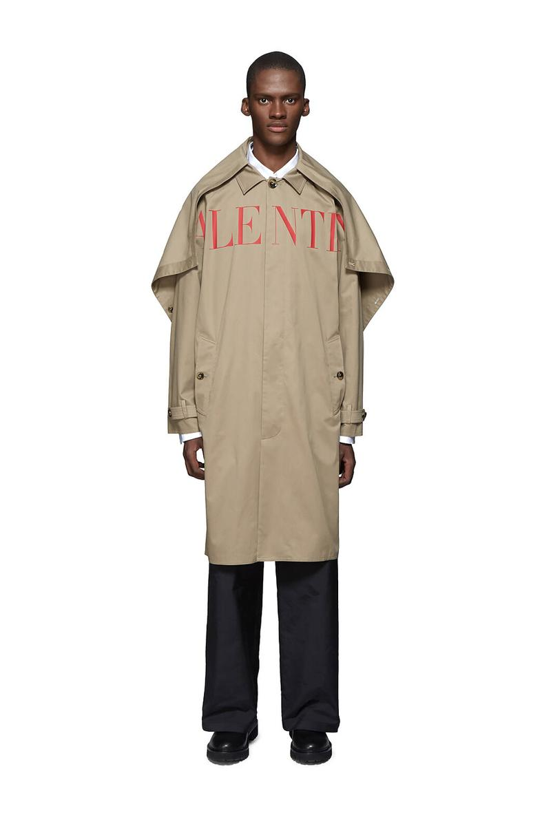 Valentino Time Traveller Coat in Black Logo Trench Coat in Beige graphics ufo flying saucers white red serif font undercover cape concealed central opening