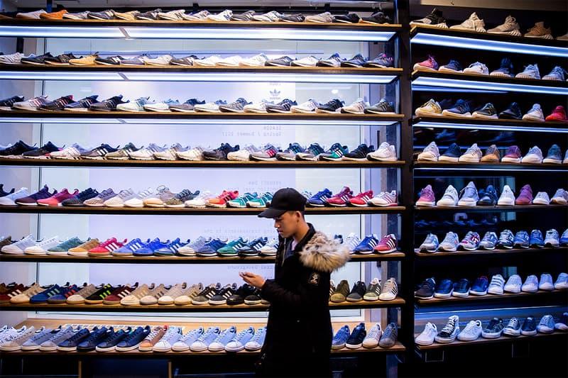 China Topsports 1 2 Billion USD Hong Kong IPO initial public offering nike adidas sportswear belle international footwear brand distributor retailer