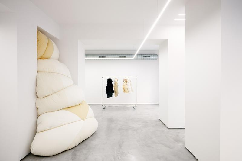 Jil Sander via sant andrea store milan installation space rotating exhibitions monthly gallery luke lucie meier creative director down jackets