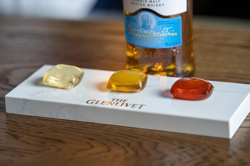 Glenlivet Scotch Capsules Gushers Cocktails London Cocktail Week Whiskey Single Malt Alex Kratena Tayēr + Elementary Pods Experience Biodegradable Sustainable Packaging Notpla Transluscent Design Food Beverage Consumption Alcohol
