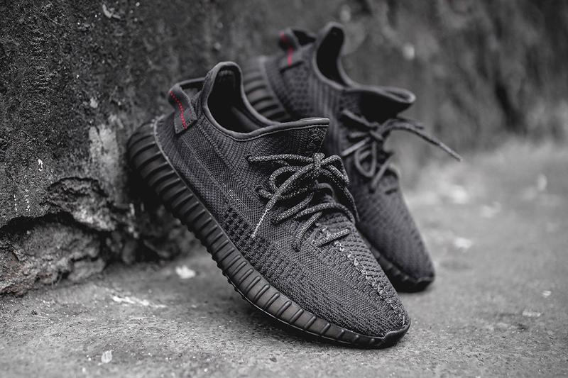 "StockX adidas YEEZY Boost 350 V2 ""Static Black"" black upper black midsole black sole rubber outsole translucent side strip Primeknit Boost tech cushion heel pull tab bright red stitching Reflective version of adidas YEEZY BOOST 350 V2 Static Black"
