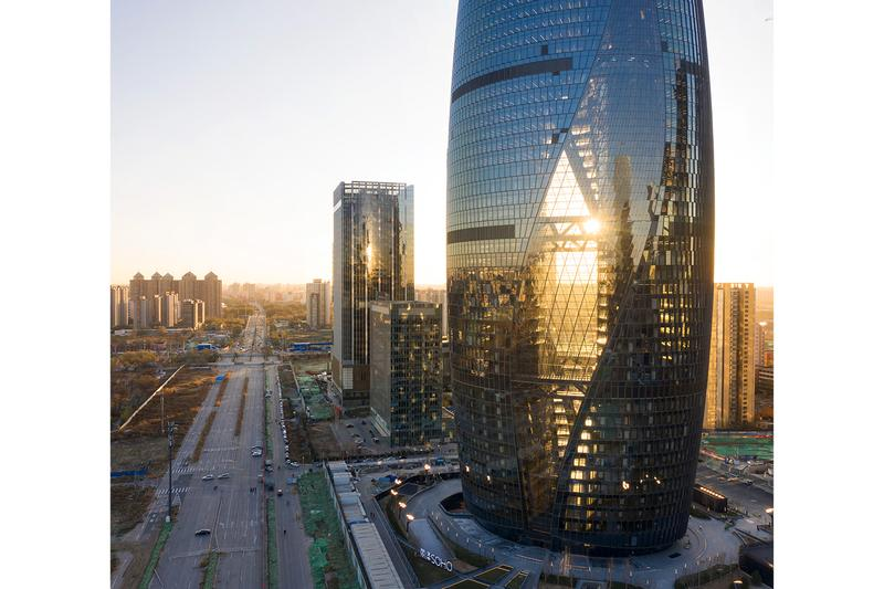 Zaha Hadid Architects Leeza SOHO Opening world's tallest atrium beijing buildings architecture pictures gallery LEED Gold certification 45-story sustainability environment pas de deux