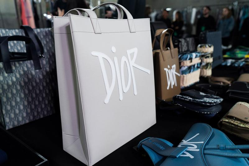 Backstage at Diors Fall Winter 2020 Miami Preview shawn stussy beach architecture couturier yoon ahn ambush jewelry French luxury house American art basel collaboration logo saddle bag pre
