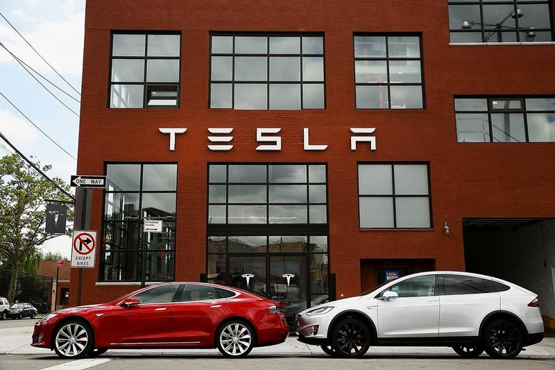 tesla elon musk electric cars vehicles stock price record high wall street investment