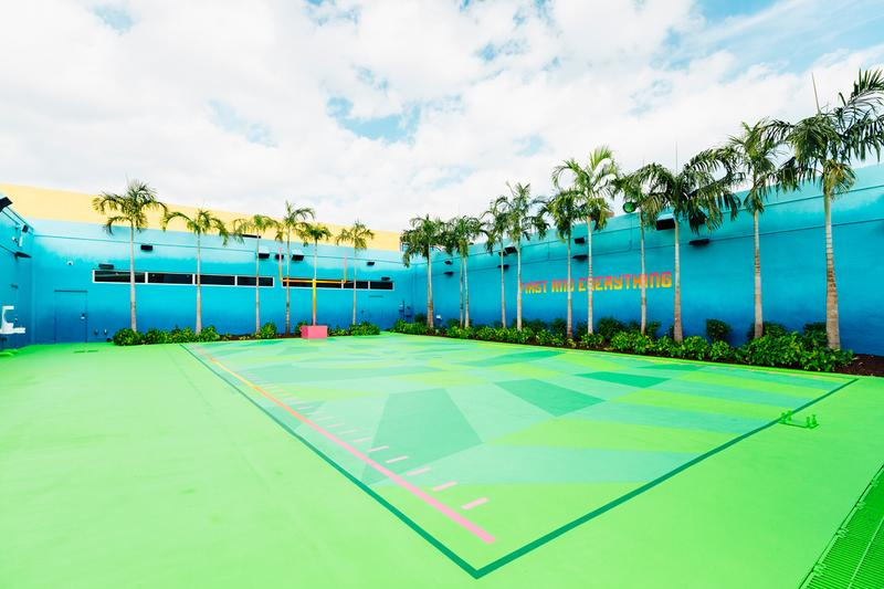 """Jessy Nite UNKNWN Wynwood Football Field Mural Nike Green Field Goals Orange Yellow Pink """"First and Everything"""" Blue Miami Super Bowl LIV"""