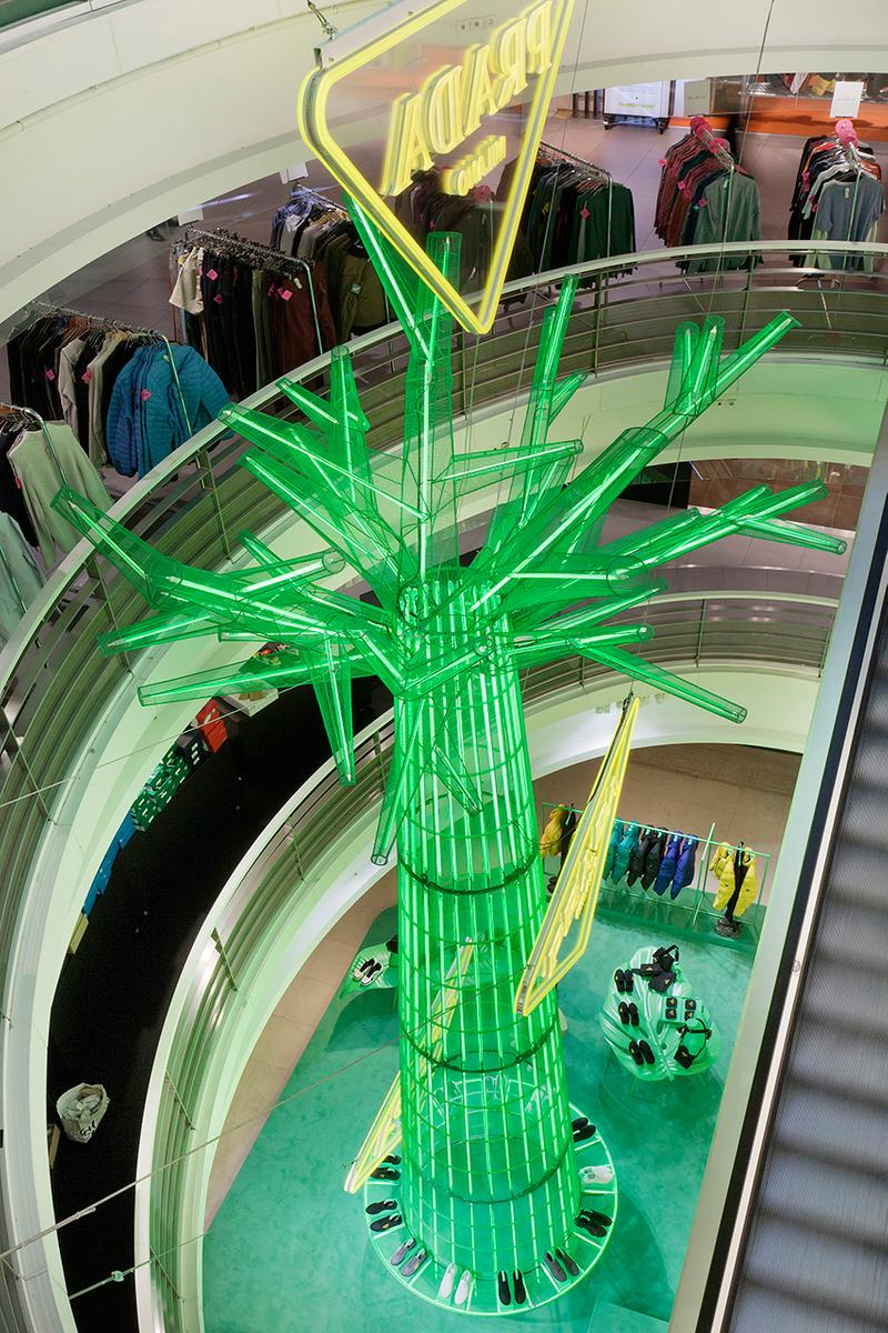 Prada Takes Over Galeries Lafayette Hyper Leaves Retail Installation paris fall winter 2020 collection footwear nature tropical neon green signs