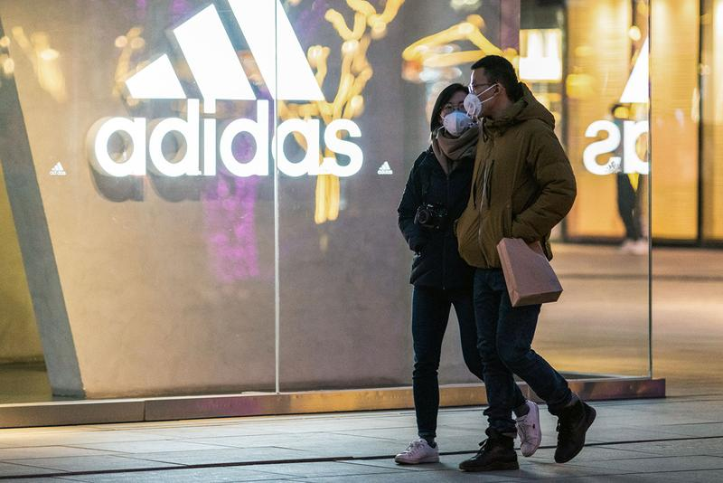 adidas, PUMA Warn of Coronavirus Revenue Slump sales closures store illness china business