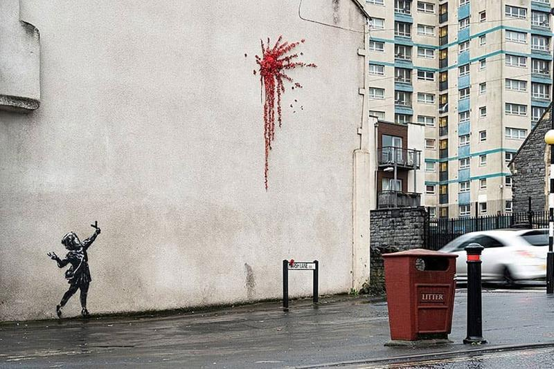 Banksy Unveils Valentine's Day Mural in Bristol Cupid With Slingshot Red Flowers Explosion Wall Spray Painted Ivy Graffiti House Artworks Closer Look