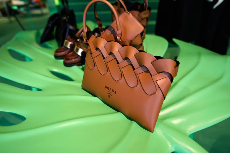 prada hyper leaves in store installation party beverly hills store new york miami installation neon green yellow palm trees nature display spring summer 2020