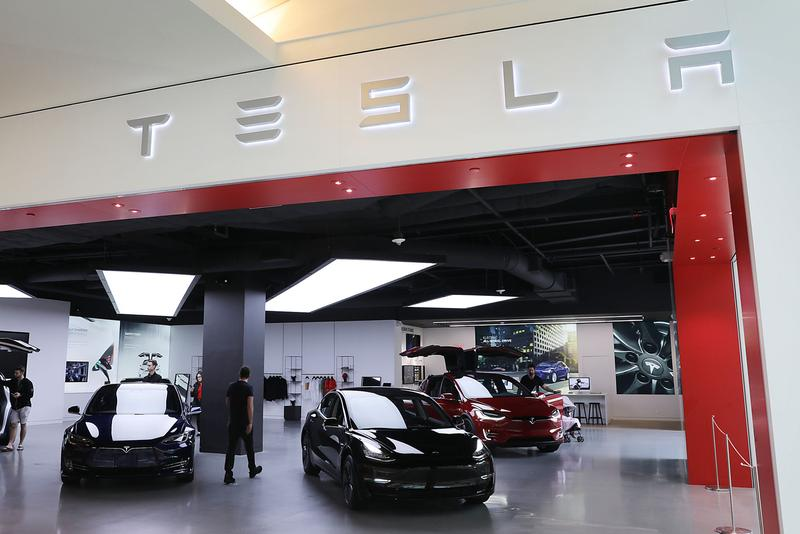 tesla elon musk electric cars vehicles automaker american trading stock price finance investment