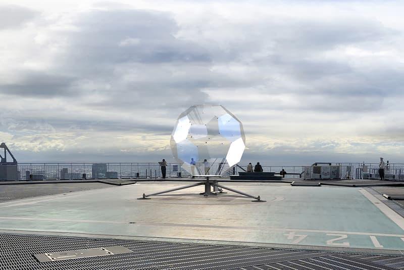 Vincent Leroy Illusion Lens Installation tokyo rooftop large scale sculpture Roppongi Hills Mori Tower helicopter landing helipad transportation geode kaleidoscope