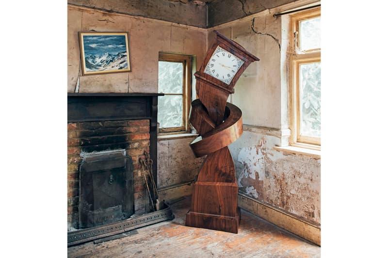 alex chinneck surreal grandfather clock sculpture Hickory dickory hokey cokey