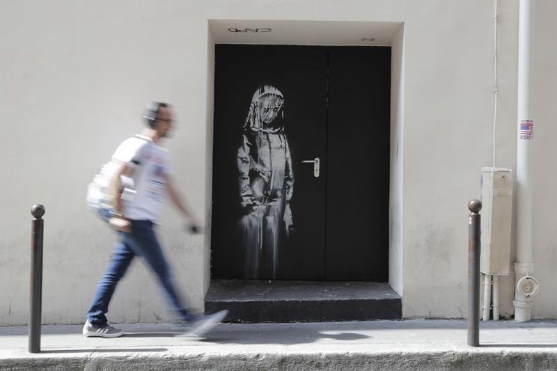 Banksy Bataclan Mural Found in Italy Paris Terrorist Attacks Theater Girl Mourning Door