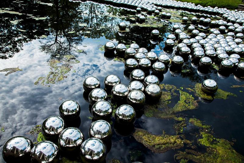Yayoi Kusama 'Narcissus Garden' in Arkansas installation site-specific mirrored orbs The Momentary industrial setting