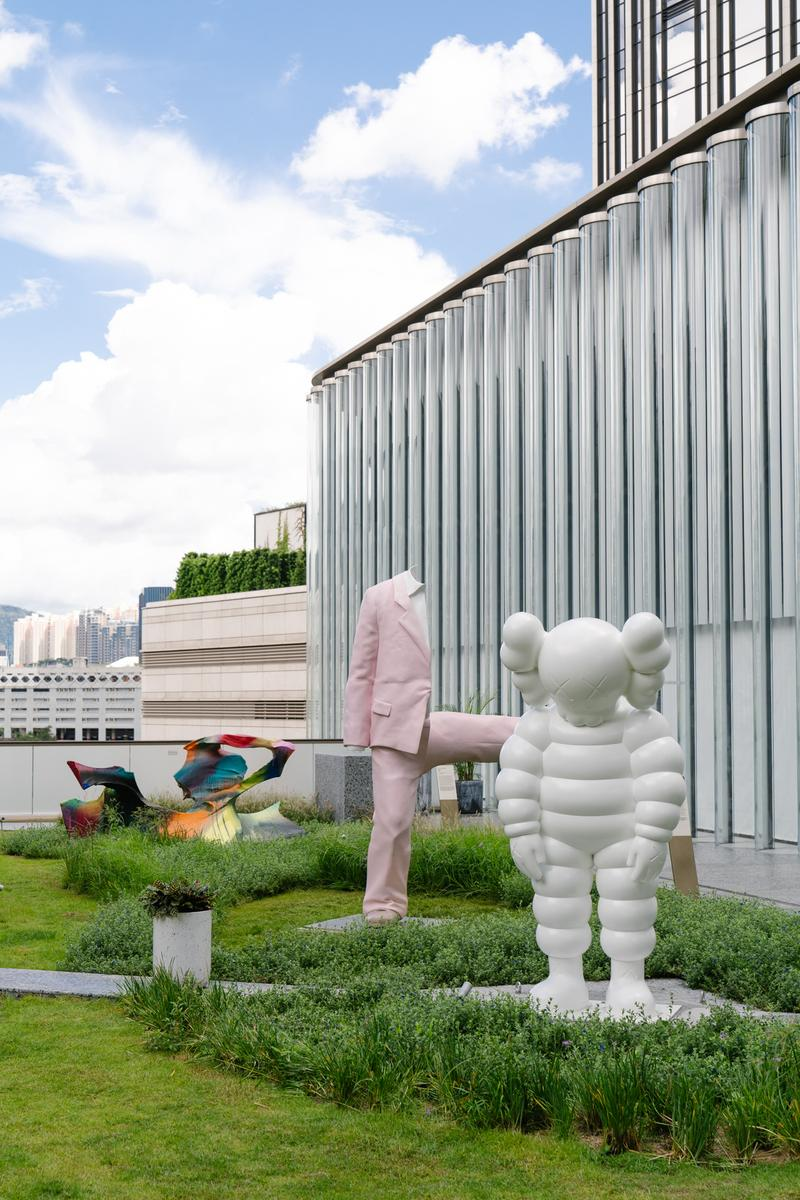 kaws what party installation statue figure sculpture