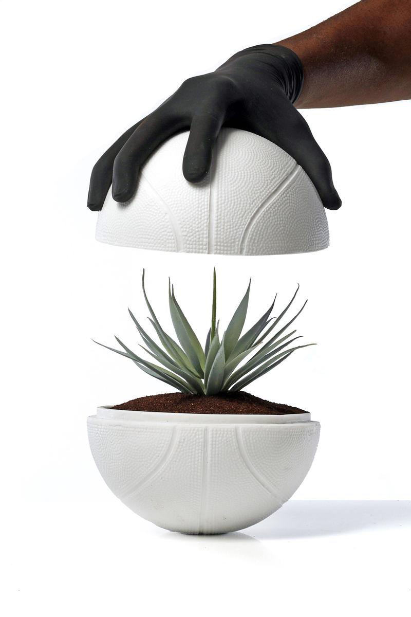 synthetic placement plant bilingual planting instructions in both English and Spanish, a certificate of authenticity custom designed protective housing encasement Tequila Don Julio 1942 packaging NBA creative community agave planter